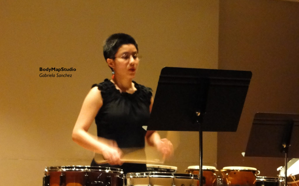 Gabriela playing a snare drum solo.